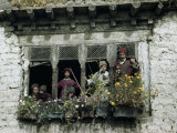 Ladakhi Family Looks Out Window Lined by Blossom-Filled Window Boxes Photographic Print by Volkmar K. Wentzel