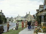 Villagers Chat on a Cottage-Lined Street Photographic Print by Melville Grosvenor