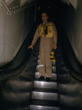 Pilot in Flight Suit Rides Escalator from Ready Room to Flight Deck Photographic Print by Melville Grosvenor