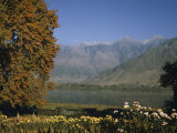 Himalayan Mountains Shelter a Tranquil Lake Photographic Print by Volkmar K. Wentzel
