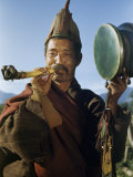Red Sect Lama Carrying Drum Blows Horn Made of Human Thigh Bone Photographic Print by Volkmar K. Wentzel