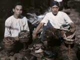 Two Men Sell Hats Made from Batik Clothes Photographic Print by W. Robert Moore