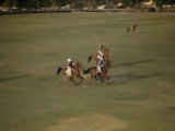 Polo Players Swinging Mallets Ride after Ball on Flat, Dusty Field Photographic Print by Volkmar K. Wentzel