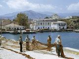 Fishermen Spread their Nets on Sun-Baked Wharves Photographic Print by Maynard Owen Williams