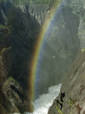 Sunlight Refracted by a Waterfall's Spray Forms a Rainbow in Canyon Photographic Print by William Gray