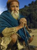 Farmer Crouches in Threadbare Clothes Photographic Print by Volkmar K. Wentzel