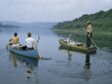 Canoeists Pass a Couple Poling a Rowboat Downriver with their Dog Photographic Print by Walter Meayers Edwards
