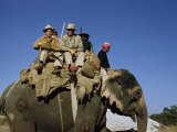 Western Scientists Ride an Asian Elephant into Western Nepal Photographic Print by Volkmar K. Wentzel