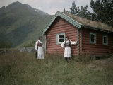 Wooden House and Two Norwegian Women in Traditional Dress Photographic Print by Gustav Heurlin