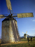 People with a Dog Stand Beside a Giant Windmill Photographic Print by Luis Marden