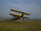 Crop Duster Soars Low to the Ground to Spray a Cotton Field Photographic Print by Joseph Baylor Roberts