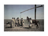 Cowboys in Sheepskin and a Horse Center around a Well in the Puszta Photographic Print by Hans Hildenbrand