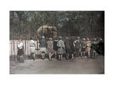 Group of Kids Looks at an Elephant in the National Zoo Photographic Print by Jacob Gayer