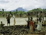 Watusi Man Supervises the Work of Bantu Laborers Photographic Print by W. Robert Moore