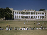 Students and Teachers Lie a Lawn to Watch Colleagues Play Soccer Photographic Print by Volkmar K. Wentzel