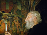 Greek Priest Inspects Byzantine Paintings in Basilica of the Nativity Photographic Print by Maynard Owen Williams