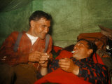 Trappers Who are Cousins Rest and Laugh Inside a Camping Tent Photographic Print by Andrew Brown