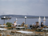 People Relax in Sunshine at Terrace Overlooking Harbor Photographic Print by Dr. Gilbert H. Grosvenor