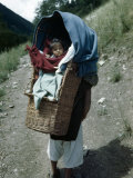 Servant Carries a Young Girl in a Large Basket on His Back Photographic Print by Volkmar K. Wentzel