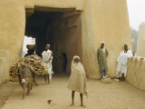 People Headed to Market Enter Kano Through a Large Adobe Gate Photographic Print by Dr. Gilbert H. Grosvenor