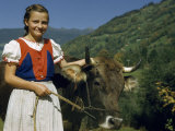 Smiling Girl Stands Beside Her Milk Cow Photographic Print by Volkmar K. Wentzel