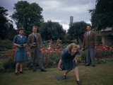 Textile Workers Bowl on a Lawn in a Flower Garden Photographic Print by Melville Grosvenor
