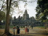 Tourists Visit a Ruined City of the Vanished Khmer Empire Photographic Print by Joseph Baylor Roberts