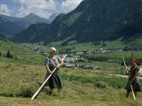 Women Use Poles to Turn Hay Drying in Sun in Alpine Valley Photographic Print by Volkmar K. Wentzel