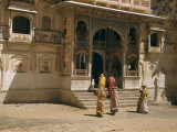 Women and a Dog Enter Ornately Decorated Temple Photographic Print by Volkmar K. Wentzel