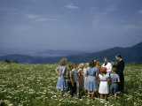 Minister Talks to Children Standing in Meadow Overlooking Valley Photographic Print by Justin Locke