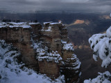 From Afar, Tourists Can Be Seen at a Snow-Covered Scenic Overlook Photographic Print by Michael Nichols