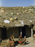 Women and Child Sit Outside Home with Sod Roof on Which Squashes Grow Photographic Print by Volkmar K. Wentzel