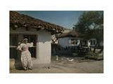 Slavic Gypsy Woman in Front of Her House Photographic Print by Hans Hildenbrand