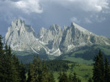 Jagged Mountain Peaks Tower over Green Alpine Valley Photographic Print by Volkmar K. Wentzel