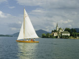 Sailboat Cruises Alpine Lake Near Village with Pilgrim Church Photographic Print by Volkmar K. Wentzel