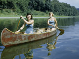 Women Demonstrate a Native American Style of Paddling a Canoe Photographic Print by Walter Meayers Edwards