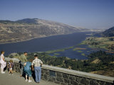 Tourists Stand at Windy Overlook Above Columbia River Gorge Photographic Print by Ralph Gray