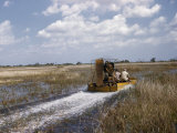 Men Drive an Air Boat over Grassy Shallows Photographic Print by Willard Culver
