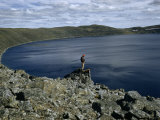 Scientist Overlooks Wind-Ruffled Water of a Crater Lake Photographic Print by Richard Hewitt Stewart
