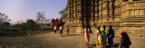 Tourist in a Temple, Khajuraho Temple, Khajuraho, Chhatarpur District, Madhya Pradesh, India Photographic Print by  Panoramic Images
