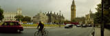 Traffic in Front of a Clock Tower, Big Ben, City of Westminster, London, England Photographic Print by  Panoramic Images