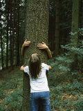 Two Girls Hugging a Tree, Germany Photographic Print