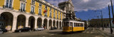 Cable Car in Front of a Building, Praca Do Comercio, Lisbon, Portugal Photographic Print by  Panoramic Images