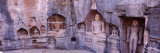 Buddha Sculptures on a Wall, Gwalior Fort, Gwalior, Madhya Pradesh, India Photographic Print by  Panoramic Images