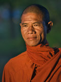Burma, Rakhine State, A Buddhist Monk Enjoys the Late Afternoon at Sittwe, Myanmar Photographic Print by Nigel Pavitt