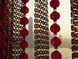 Curtain of Chinese New Year Decorations Frame Victoria Harbour from Tsim Sha Tsui, in Hong Kong Photographic Print by Andrew Watson