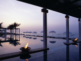 Reflections in the Still Water of the Infinity Pool at Sunset, at the Chedi Hotel Photographic Print by John Warburton-lee