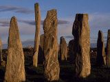 Sunset over the Central Circle of Ancient Standing Stones at Callanish, Dating to Neolithic Times Photographic Print by Mark Hannaford