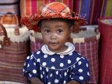 Young Girl Beside a Road-Side Stall Near Antananarivo, Capital of Madagascar Photographie par Nigel Pavitt