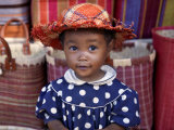 Young Girl Beside a Road-Side Stall Near Antananarivo, Capital of Madagascar Fotografisk tryk af Nigel Pavitt